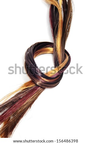 lock of hair of different colors on a white background - stock photo