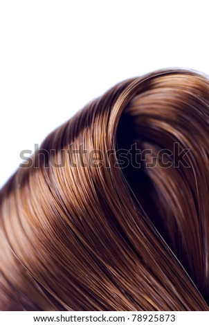 Lock of silken brown hair isolated on white background - stock photo
