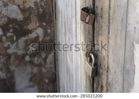 lock the door with padlock, old padlock and old wooden door - stock photo