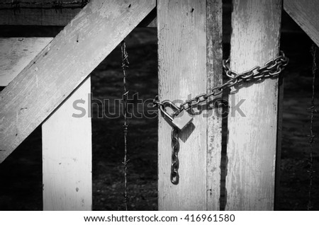 lock with chain in black and white - stock photo