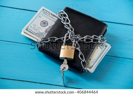 locked dollar money purse with metal chain link with padlock - stock photo