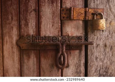 locked old wooden door. - stock photo