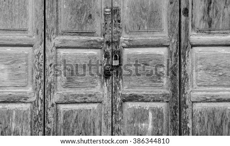 Locked old wooden door (black and white)