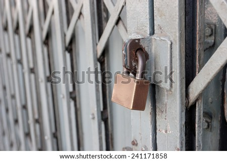 Locked on sliding steel door, Selective focus and copy space. - stock photo