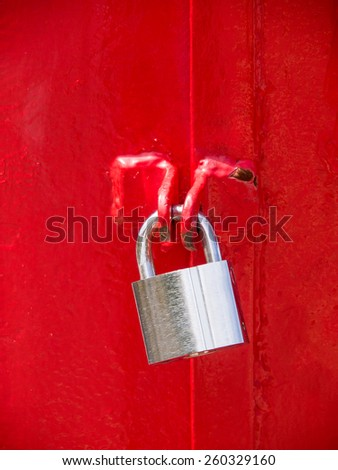 locked padlock on red - stock photo