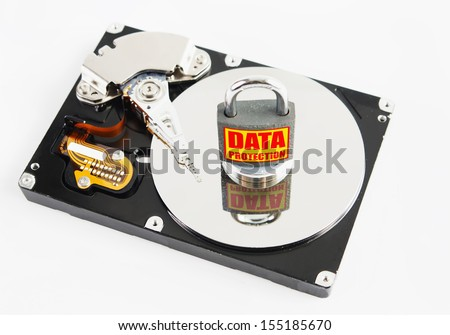 Locked padlock over hard disk drive - stock photo