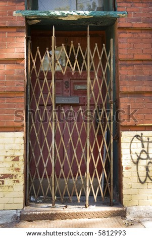 locked rusted old door leading to nowhere in New York
