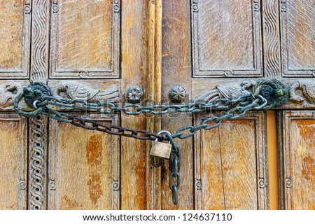 Locked wooden door - stock photo