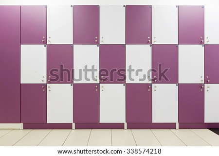 Locker room with purple lockers - stock photo