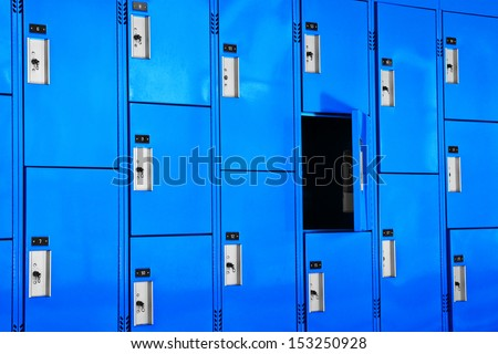 Lockers come in all sizes, shapes, and colors. There is an open locker in this group. - stock photo