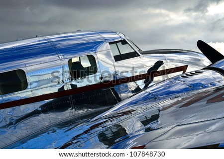 Lockheed Electra Jr. - A perspective view of a vintage Lockheed Electra Jr.. A polished and shiny fuselage; the essence of the golden era of aviation. - stock photo