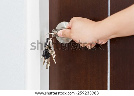 Locking or unlocking door with key by hand