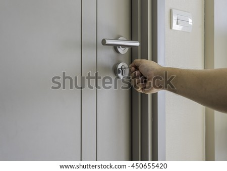locksmith man try to open the door by key - can use to display or montage on products - stock photo