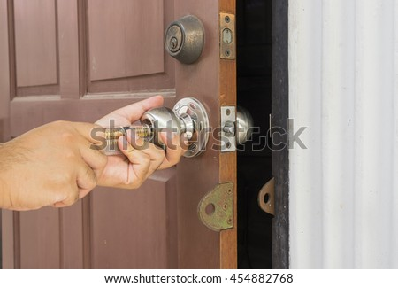 locksmith open the door by special tool for key lost - can use to display or montage on products - stock photo