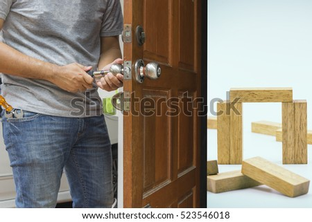 locksmith open the wood door to house loan concept - can use to display or montage on product