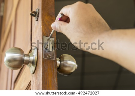 locksmith repair the knob on old wood door - can use to display or montage on product