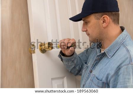 Locksmith repairs lock - stock photo