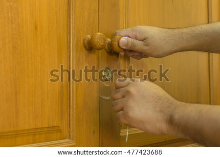 locksmith use a small steel tools for open wood closet - can use to display or montage on product