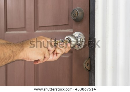 locksmith use tool for open the door locked - can use to display or montage on products or concept crack the door - stock photo