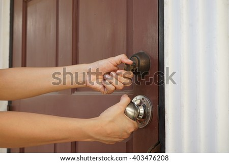 locksmith will open the door with unknown key for background - stock photo