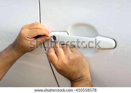 locksmith will open white car door , service key - stock photo