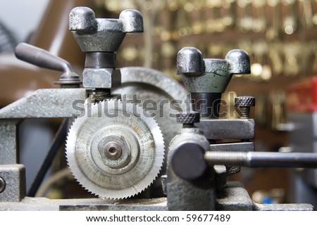 Locksmiths machine with blurred background of keys - stock photo