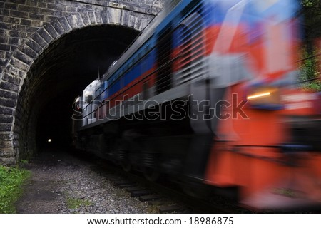 Locomotive driving out from tunnel.  Old, long (0.78 km) and straight railroad tunnel of the Circum-Baikal Road - stock photo