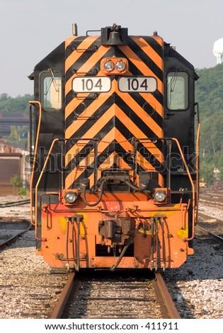 Locomotive in rail yard. - stock photo