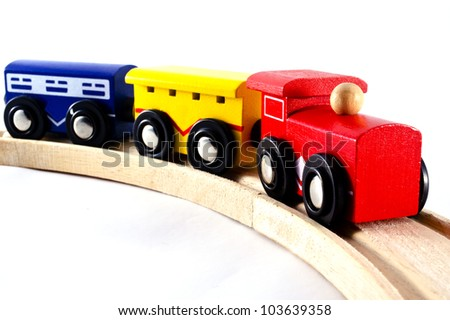 Locomotive train engine and rail cars model toy  isolated on a white background. Concept photo for transport ,transportation, retro, old, vintage ,design.  - stock photo