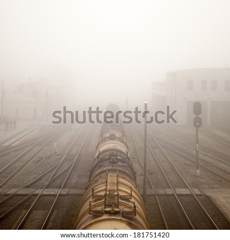 locomotive train in fog on station - stock photo