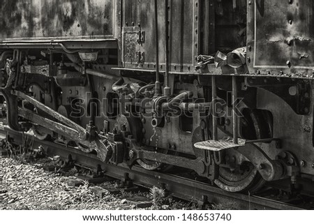 locomotive wheels black and white photography