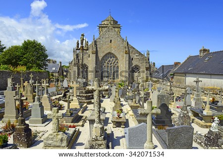 "LOCRONAN, FRANCE - JULY 7, 2015: The Saint Ronan church at Locronan in Brittany. Locronan is a member of the ""The most beautiful villages of France"" association."
