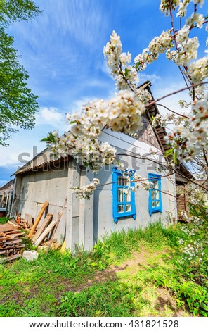 Lodge and cherry blossom in spring time (wide angle) - stock photo