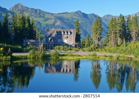 Lodge reflected in a lake in the mountains of Washington State