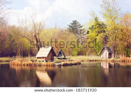 Lodges on the shore of lake - stock photo
