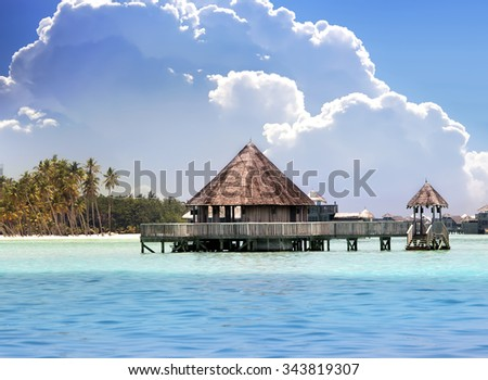 Lodges over transparent quiet sea water- tropical paradise