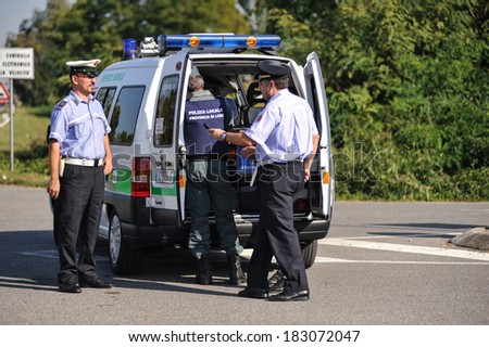 LODI, ITALY - OCTOBER 3: Checkpoint control and alcohol during a demonstration in the city of Lodi, Italy on October 3, 2011. Monitoring police Safety Camera