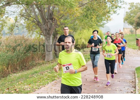 LODOSA - SPAIN - NOVEMBER 02: Group of athletes in the first run solorunners in Lodosa. Celebrated in Lodosa on November 02, 2014 - stock photo
