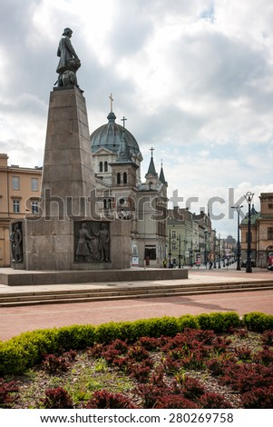 LODZ CITY, POLAND - MAY 17,  2015: Liberty Square view in direction of Piotrkowska Street.  Tadeusz Kosciuszko statue and Church of Descent of the Holy Spirit - stock photo