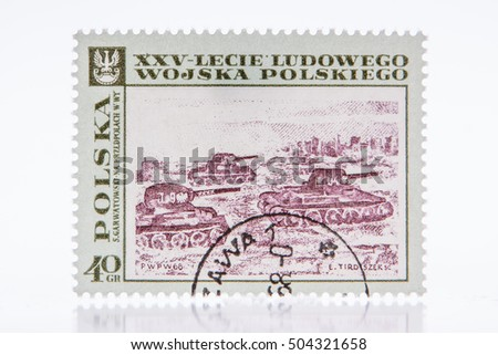 "Lodz, Poland, circa 1968 a stamp printed in Poland shows painting ""Tanks before Warsaw"" by Garwatowsk, with inscription and name of series ""25th Anniversary of Polish People's Army"","
