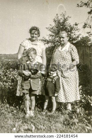 LODZ, POLAND, CIRCA FIFTIES: Vintage photo of grandmother and mother with sons