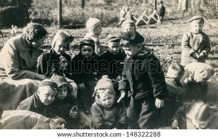 LODZ, POLAND, CIRCA FIFTIES - vintage photo of group of pupils in kindergarten , Lodz, Poland, circa fifties - stock photo