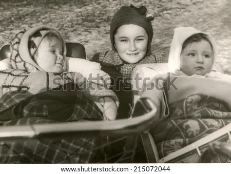 LODZ, POLAND, CIRCA FIFTIES: Vintage photo of three little girls