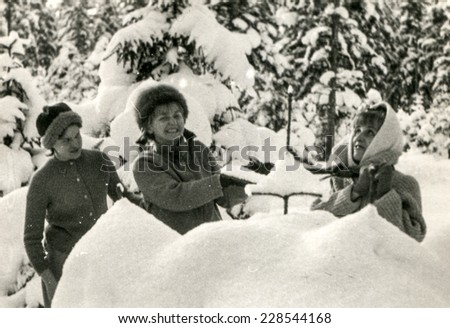 LODZ, POLAND, CIRCA FIFTIES: Vintage photo of women playing in snow
