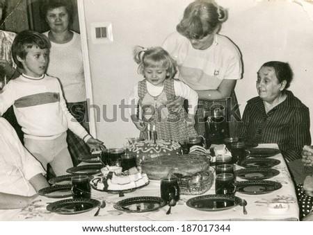 LODZ, POLAND CIRCA 1970's: Vintage photo of family enjoying a family party (child birthday) - stock photo