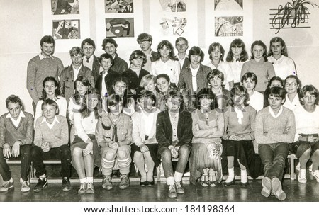 LODZ,POLAND, CIRCA 1970's: Vintage photo of group of  classmates posing together at school - stock photo