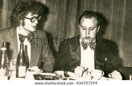 LODZ, POLAND, CIRCA 1970's: Vintage photo of two young men during a party - stock photo