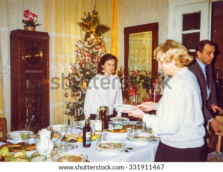 LODZ, POLAND, CIRCA 1990: Vintage photo of family during a Christmas party