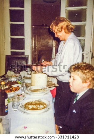 LODZ, POLAND, CIRCA 1988: Vintage photo of grandaunt and a little boy during a Christmas party - stock photo