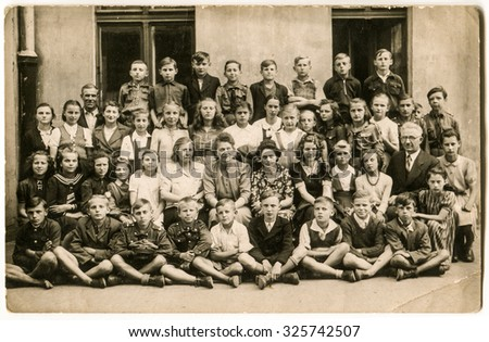 LODZ, POLAND, CIRCA 1940:  Vintage photo of group of school pupils and their tutors